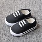 รองเท้าผ้าใบเด็กเชือกร้อย-สีดำ-(8-คู่/แพ็ค)