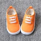 รองเท้าผ้าใบเด็กเชือกร้อย-สีส้ม-(8-คู่/แพ็ค)