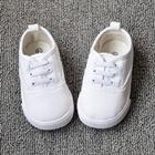 รองเท้าผ้าใบเด็กเชือกร้อย-สีขาว-(7-คู่/แพ็ค)