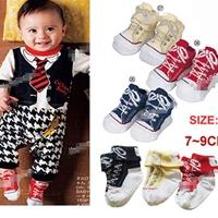 ถุงเท้าเด็กลายรองเท้าผ้าใบสดใสคละสี-(24-คู่-/pack)