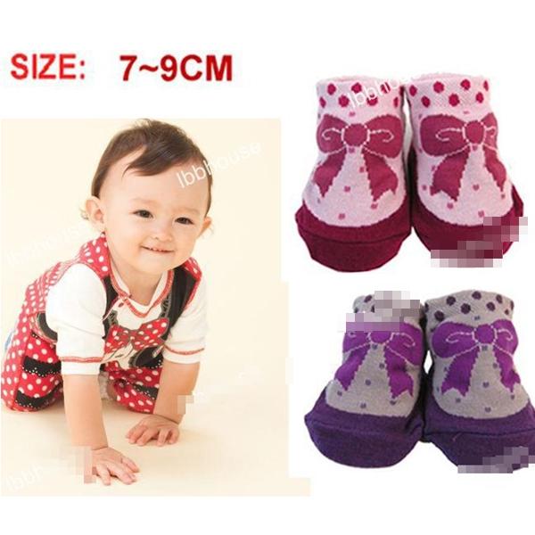 ถุงเท้าเด็กลายจุดและโบว์ คละสี (20 คู่ /pack)